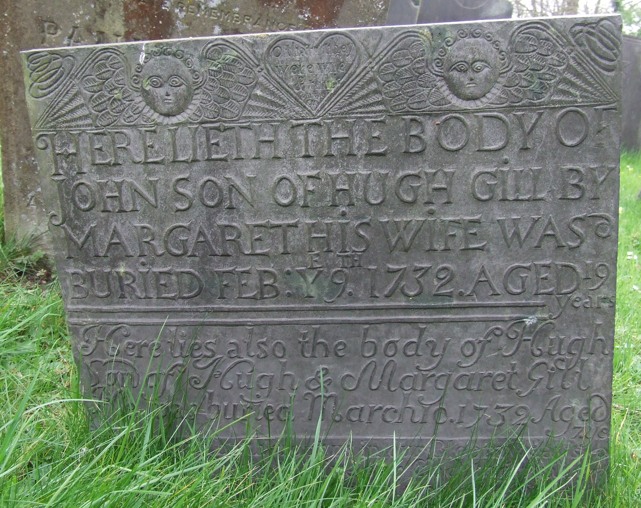 Headstone with two cherubs