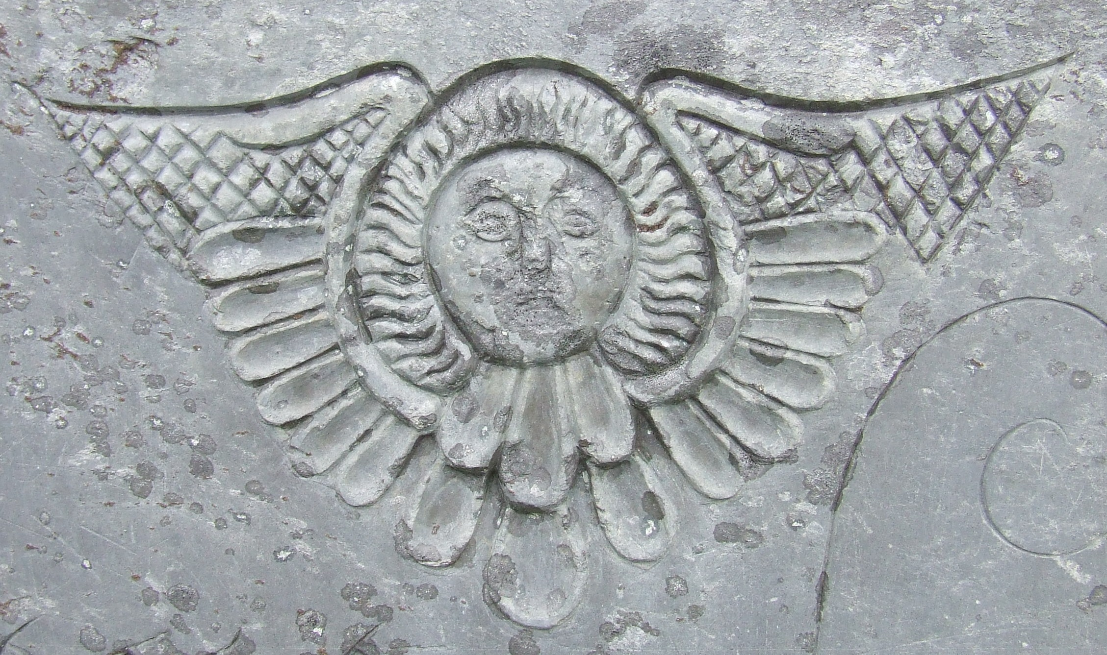 Carving of a cherub on a gravestone