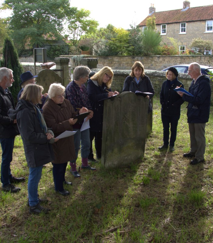 The Slingsby group receive tuition on how to record gravestones